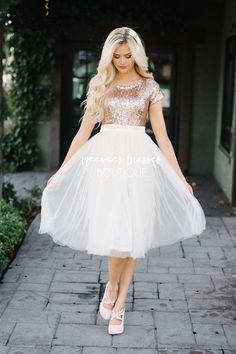 This feminine dress is everything you have been looking for! Sequins, sparkles, tulle and modest too! The bodice features short sleeves, a round neckline and is covered in tiny rose gold sparkly sequins. It is follow by a cream tulle skirt.