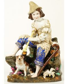 A PORCELAIN FIGURE OF A PASTOR BOY WITH HIS DOG KORNILOV BROTHERS PORCELAIN FACTORY SAINT PETERSBURG 1850S