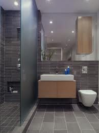 tile wall & wall mounted toilet. I like the frosted glass shower wall.