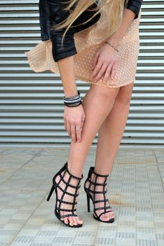 Add a little bit of edge with black cage heels.