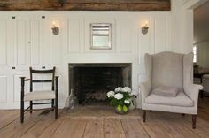 FARMHOUSE – INTERIOR – a raised panel wall around the fireplace.