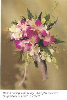 Tropical wedding bouquets are filled with exotic flowers and (usually) bright colors. Orchids are a favorite warm climate flower and this first bouquet is bursting with them.    A mixture of white and fuschia dendrobium orchids create an beautiful cluster of flowers enhanced with cool green ferns.