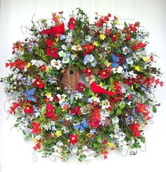 Americana Wreath, Patriotic Wildflower Wreath, 4th of July Wreath, Birdhouse Cardinals, Butterfly Wreath, Wall Wreath, Door Wreath, Stars, BETWEEN STORM DOOR AND MAIN DOOR~APT OR CONDO.... Handcrafted, on a wild twig base, this colorful wreath is full of wildflowers and wild grasses. I have placed a wooden hand painted birdhouse with an Americana design to it in the design and around that I added silk mini daisies, parchment mini poppies, flax astible, blossom blooms, wild twigs, wild…