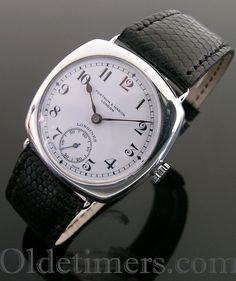 A silver cushion vintage Longines watch, retailed by Fortnum & Mason, London, 1936