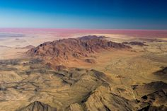 Mountain Range of Sossusvlei, Namibia - This image was shot flying over Namibia.  The red color in this area was striking along with the natural markings of the geography.