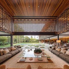 HONEY I'M HOME | We're (mentally) putting this straight on our vision board 🎯 Famed architect firm Jacobsen Arquitetura have truly outdone themselves with this Brazilian oasis ☀️🏡🌴 alternating timber panels ✔️ private pool ✔️ lush garden ✔️ and the living room of all living rooms ✔️ #superelixir #superelixirloves #design #architecture #interiors #lifestyle #landscapedesign