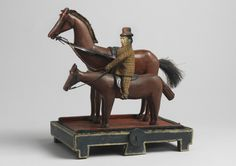 "Rare and Engaging Figurative Folk Art Sculpture Of Two Horses And A Rider Hand Carved and Painted Wood, Leather and Mixed Media Inscribed 'Hickmey Jack' English, c.1890 12.00"" high x 10.75"" wide x 7.50"" deep"