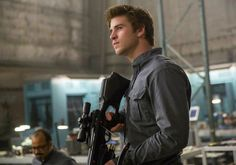 Pin for Later: Best of 2014: The Sexiest Pictures From the Big Screen Mockingjay —Part 1 Gale looks especially tough and sexy here.