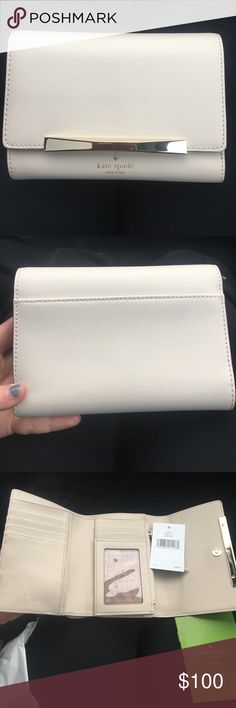 Kate Spade Callie Camden Way Wallet NWT Cream Brand New with Tags and comes with shopping bag. White/ cream leather wallet with gold metal accents. Has many slots for cards, a zippered pouch for coins, and a place for cash.                                                Approx Dimensions: 6 in (L) x 4 in (H) x 1 in (W) kate spade Bags Wallets