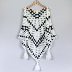 Put a modern spin on a crochet classic with this simple crochet granny stitch shawl! The Newsprint granny stitch shawl uses rhythmic stripes to modernize this iconic stitch. The resulting piece is light, super warm and can be worn around the shoulders as a shawl or around the neck as a triangle scarf. Add tassels or fringe to create a versatile statement piece you can wear all season long. Find this pattern and more inspiration at LoveCrochet.Com.