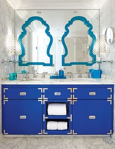 Contrasting blue hues breathe life into a modern bath at Florida's Eau Palm Beach Resort & Spa