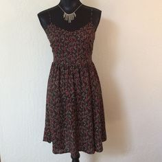"""Edgy, if you want it that way. Add some short booties and edge it up. Or, take it down with short wedges or flats. 100% soft rayon. Fitted with side zipper.  Black muted dress with red triangles and dots. Fitted bodice. 35"""" from shoulder to hem. Extends at straps another 2-3"""". Waist is 14"""" across.  In great condition.  Purchased at Nordstrom. one clothing Dresses"""