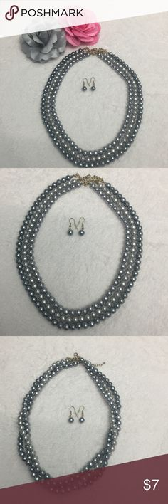 Three strand grey faux pearl set Three strand grey faux pearl necklace with three shades of grey. Dangle earrings complete the look. Necklace can be worn twisted or not depending on how you want it to look. Jewelry Necklaces