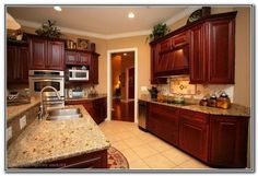 french country kitchen with loads of color cherry wood floors and