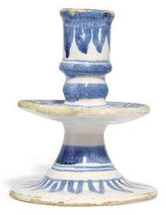 AN ENGLISH DELFT BLUE AND WHITE CANDLESTICK