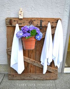 old barn door turned into wall coat or towel rack, that's what i'll do with one of the two that I have