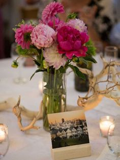 Lupe Farms in San Francisco designed the couple's centerpieces and other florals. Memorable photos from the couple's Instagram accounts identified tables (instead of table numbers) at the reception. The photos were displayed in small frames made by the bride's father.