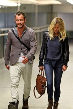 Sienna Miller Jude Law Photos - A tanned Jude Law and Sienna Miller arrive back from celebrating the New Year on holiday, in Kenya. - Jude Law and Sienna Miller Return from Kenya