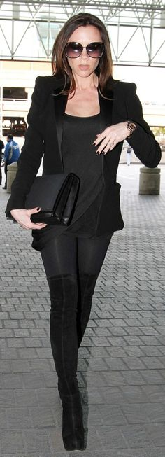 All black with over the knee boots.  Cute outfit to get cocktails in the city. #streetstyle