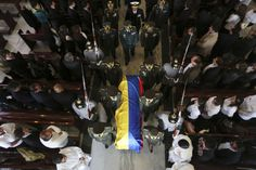 Colombian police commanders carry the casket of Major German Mendez of the Colombian police force during his funeral at a religious center in Bogota, March 20, 2014. REUTERS/ John Vizcaino