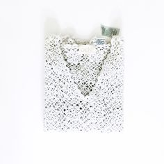 "Cache White Glitter Crochet Top It's made of 5% spandex, 10% lurex, 32% cotton, 53% Ramie. The top is about 22"" in length. The sleeve length is about 20"". The shoulder to shoulder length is about 18"". The color is off white grayish-cream. There is shiny metallic that is knitted along the yarn making a bright, lovely top.  Paper Tag attached is damaged   • BECAUSE OF LIGHTING, PLEASE BE AWARE THAT COLOR OF THE ACTUAL ITEM MAY SLIGHTLY VARY FROM THE PHOTOS • MAKE ALL OFFERS USING THE OFFER…"