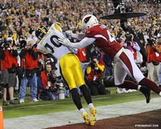 Santonio Holmes catches the winning touchdown with 35 seconds to play, as the Steelers defeat the Cardinals 27-23 in Super Bowl XLIII.