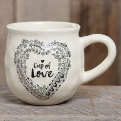 "With a handcrafted feel and generous 16-ounce size, this ""happy"" ceramic mug features ""cup of love"" saying and a heart printed on the inside bottom. Perfect for gifting. Dishwasher and microwave safe."