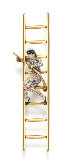 GOLD AND ENAMEL BROOCH, CARLO GIULIANO, 1880S Designed as a Harlequin carrying a slapstick whilst climbing a ladder, decorated in polychrome enamel, maker's mark for Carlo Giuliano.
