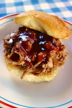 BBQ Ranch Pulled Pork {Slow Cooker}   Plain Chicken - I made this pork in the slow cooker. I thought it turned out great. I prepped the pork the night before and refrigerated it overnight. I threw the pork in the slow cooker first thing in the morning and it was ready by dinner. It was fall apart tender! The BBQ sauce is a must with this pork - it is my new favorite. This will definitely be on our Memorial Day menu - it should be on yours too!