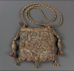 Drawstring bag, 1575-1625  Linen; plain weave embroidered with silk, metallic threads, wire, metal purl, spangles, glass bead; braided silk cords and tassels  2 person braid? Braid made with same embroidery silk as bag?