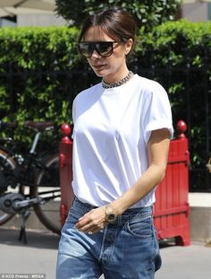 Casual: The fashion designer, 44, sported a basic white T-shirt and high-slung jeans for her latest appearance in the French capital