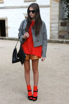 Red rolled up over knee socks, black wedge heels, brown leather shorts, red ample shirt, grey jacket