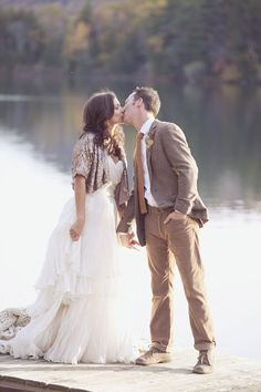 Gorgeous shot of a bride and groom at their fall wedding day | http://www.weddingpartyapp.com/blog/2014/11/11/15-romantic-fall-wedding-photos-thatll-convince-fall-wedding/