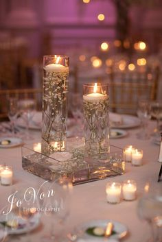 #receptiondecor #floatingcandles #centerpiece #babybreath #laurelwooddesigns #theknot #weddingwire