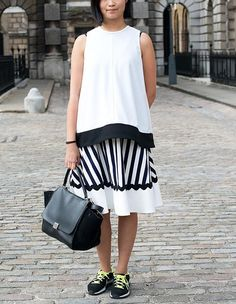 7 Surefire Ways to Pull Off Sneakers and Skirts from InStyle.com