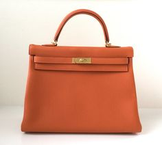 *** BRAND NEW IN BOX ***NEVER USED *** Hermes Kelly bag 35*** Orange Togo leather with gold hardware
