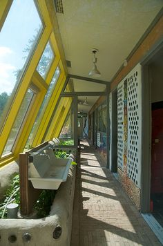The Earthship in Zwolle showing indoor greenhouse & bottle wall. This is our front wall plan for sure!