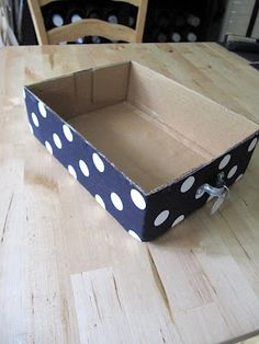covered box tutorial - great detailed instructions for covering boxes with fabric for storage. includes deets for adding a handle/drawer pull