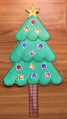 "Place Value Activities: Another example of a place value Christmas tree. This is a simple, two-digit one. The ornaments are ""ones"" blocks & the trunk is made up of two, rods. Super-fun craft for children. Interesting math bulletin board display too."