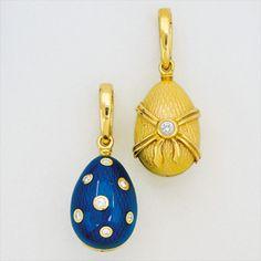 Two Diamond, Enamel and 18K Gold Egg Pendants, Fabergé with original boxes. Signed Fabergé, Germany. (est. cost: 1,400.)