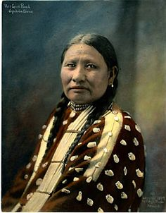 Sioux woman Good Road wearing elk tooth dress, 1899