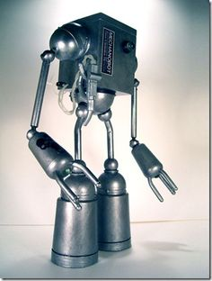 A robot sculpture made from motorcycle parts.