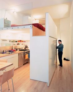 """Ingenious NYC Apartment"" / about 625 sq ft / Loft bed over kitchen has standing space over the adjacent closets./ See info about the stairs, at right / Details on the space, here:  http://www.dwell.com/house-tours/article/big-city-little-loft   AND more info here:  http://dornob.com/loft-bed-turns-single-floor-studio-to-two-level-apartment/"