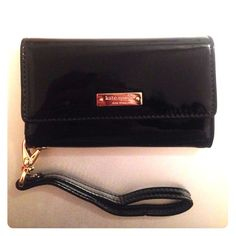 Kate Spade iPhone 5/5s/5c wristlet Perfect, like new condition!!! Black patent leather wristlet with gold Kate Spade logo; striped cotton interior with black leather trim. It's a phone case (iPhone 5/5c/5s), has 4 card slots, and a small pocket inside for cash/change/anything! Perfect condition, just never used it bc I have too many wallets! Super cute, goes w almost every outfit and is really great for nights out when you don't want to bring a purse! kate spade Bags Clutches & Wristlets