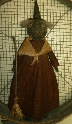 Primitive Black Standing Witch Doll with broom. Leaning against her is her broom. She is rag stuffed, painted, sanded and stained to age. Her outfit is orange & black - a tiny checkered plaid on top and orange with black stars on the bottom. | eBay!