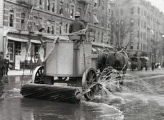 Horse drawn street cleaning... that's how it was done....