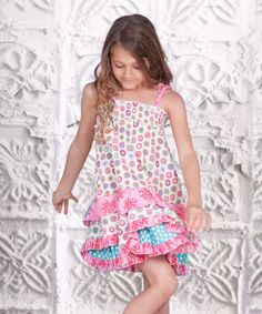 Stylish sweeties dance with steps of delight in this fanciful frock, thanks to its sweet array of prints, smocked panel and tiered ruffles. The pullover design with stretchy smocking and tie straps makes it easy for cuties to get dressed each morning.100% cottonMachine washImported