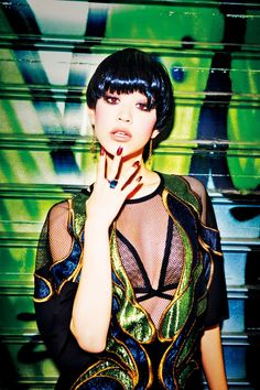 Vogue Japan. Model: Kiko Mizuhara. Fashion photography by Ellen von Unwerth. Urban, graffiti style.