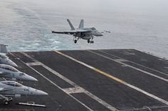 """An F/A-18E Super Hornet, assigned to the """"Fist of the Fleet"""" of Strike Fighter Squadron (VFA) 25, lands on the flight deck of aircraft carrier USS Harry S. Truman (CVN 75)."""