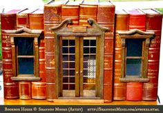 Bookbox Houses © Shannon MOORE (Artisan, Miniature Maker. Florida, USA).  Real books hollowed-out so that a miniature vignette setting can be placed inside.  Available at her website,  shannonsminis.com